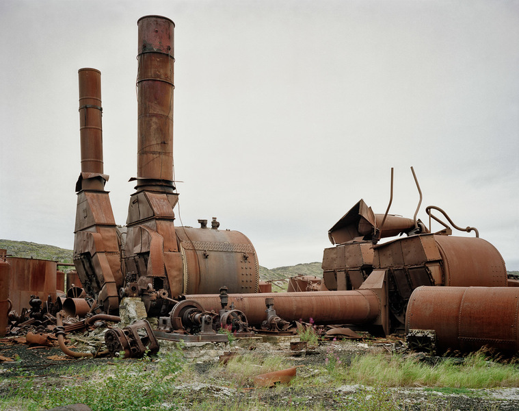 Two boilers with stacks still standing, one down